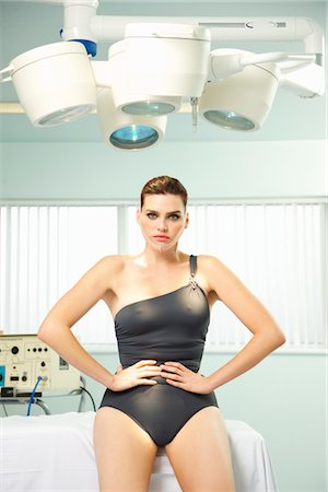 expectation - Woman with Elastic Bandage on Face Sitting under Surgical Lamp Stock Photo - Rights-Managed, Code: 822-03780782
