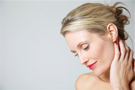 Profile of Woman Wearing Red Lipstick Stock Photo - Rights-Managed, Code: 822-03780828