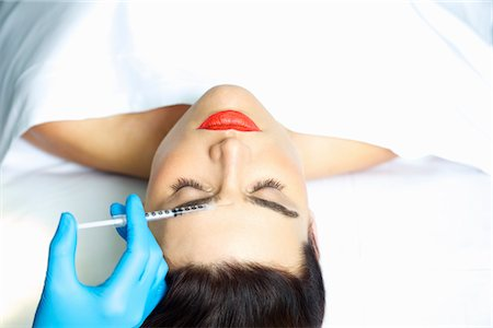 Woman Receiving Botox Injection on Forehead Stock Photo - Rights-Managed, Code: 822-03780861