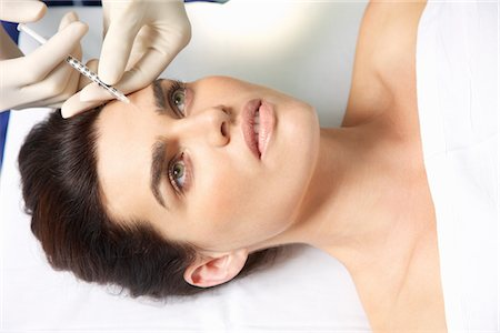 smooth - Woman Receiving Botox Injection on Forehead Stock Photo - Rights-Managed, Code: 822-03780925