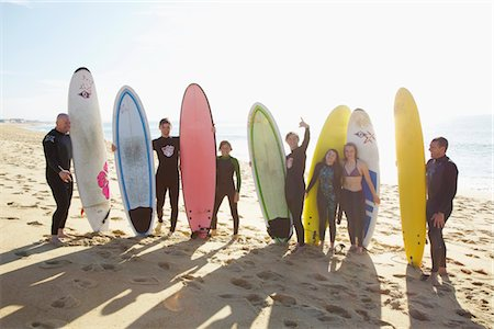 Group of Surfers Standing on Beach Holding Surfboards Stock Photo - Rights-Managed, Code: 822-03780939
