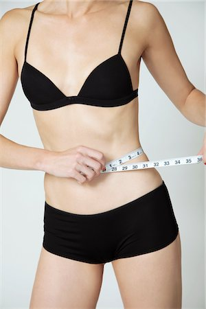 Woman Measuring Waist Stock Photo - Rights-Managed, Code: 822-03780945