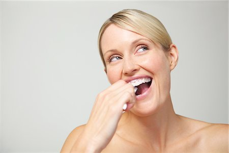 Woman Brushing Teeth Stock Photo - Rights-Managed, Code: 822-03780947