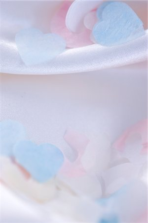 Heart Shaped Confetti on Pastel Pink Silk Stock Photo - Rights-Managed, Code: 822-03780957
