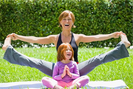 Portrait of a mid adult woman with her daughter practicing yoga Stock Photo - Rights-Managed, Code: 837-02378051