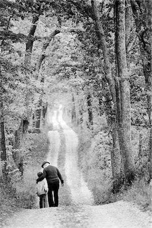 Rear view of a senior man walking with his grandson Stock Photo - Rights-Managed, Code: 837-02378066