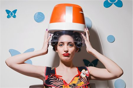 Portrait of a young woman sitting under hair dryer Stock Photo - Rights-Managed, Code: 837-02378072
