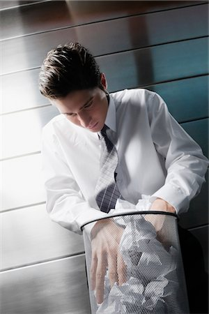Businessman searching in a wastepaper basket Stock Photo - Rights-Managed, Code: 837-02378240