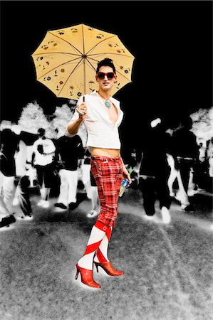 Gay man holding an umbrella and smiling Stock Photo - Rights-Managed, Code: 837-02378283