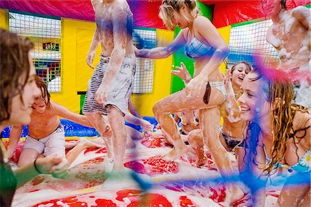 Group of friends enjoying in an inflatable pool Stock Photo - Rights-Managed, Code: 837-02378496