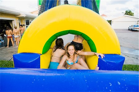 Teenage girls in an inflatable water slide Stock Photo - Rights-Managed, Code: 837-02379105