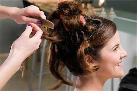 Close-up of a woman's hand combing the hair of a young woman Stock Photo - Rights-Managed, Code: 837-02379356