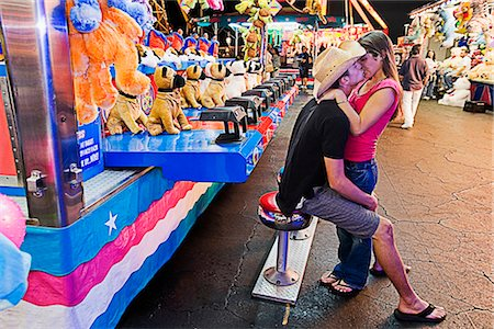 Teenage couple kissing each other in an amusement park Stock Photo - Rights-Managed, Code: 837-02379464