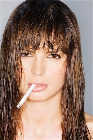 Portrait of a young woman smoking Stock Photo - Rights-Managed, Code: 837-02379532