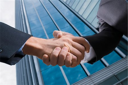 Two businessmen shaking hands Stock Photo - Rights-Managed, Code: 837-02379588