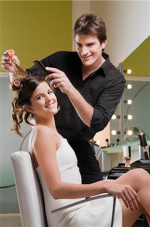 Portrait of a hairdresser adjusting the hair of a young woman Stock Photo - Rights-Managed, Code: 837-02380465