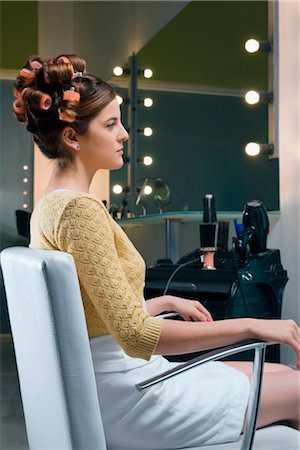 Side profile of a young woman sitting in an armchair Stock Photo - Rights-Managed, Code: 837-02380620
