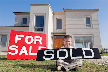 sold sign - Portrait of a boy holding a sold signboard and smiling Stock Photo - Rights-Managed, Code: 837-02380866