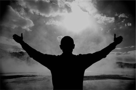 silhouette black and white - Silhouette of a man with his arms outstretched, Grand Prismatic Spring, Yellowstone National park Wyoming, USA Stock Photo - Rights-Managed, Code: 837-02380923
