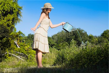 Side profile of a teenage girl watering plants Stock Photo - Rights-Managed, Code: 837-02380947