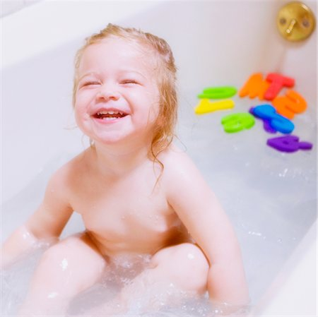 Baby girl laughing in a bathtub Stock Photo - Rights-Managed, Code: 837-02380957