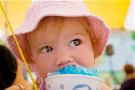 Close-up of a baby girl eating an ice cream Stock Photo - Rights-Managed, Code: 837-02381713