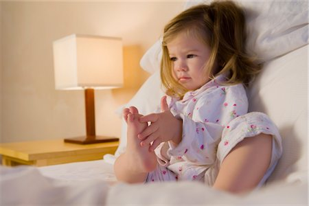 Baby girl sitting on the bed Stock Photo - Rights-Managed, Code: 837-02381879