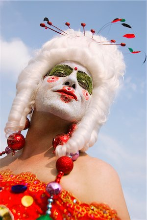 Low angle view of a gay man with face paint on his face Stock Photo - Rights-Managed, Code: 837-02381910