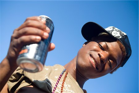 Close-up of a gay man holding a can and smiling Stock Photo - Rights-Managed, Code: 837-02382275