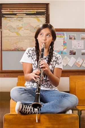 Schoolgirl playing a clarinet in a classroom Stock Photo - Rights-Managed, Code: 837-03069638