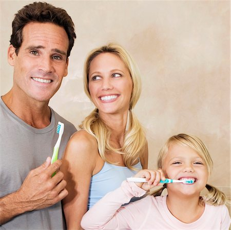 Family brushing teeth in the bathroom Stock Photo - Rights-Managed, Code: 837-03069773