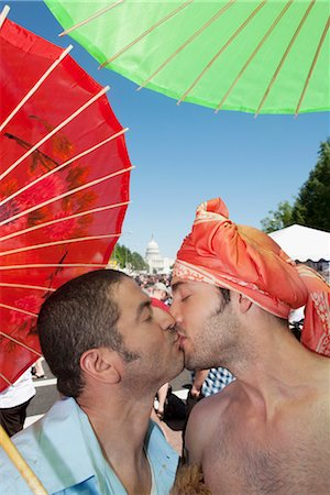 Gay couple holding parasols and kissing each other,DuPont Circle,Washington DC,USA Stock Photo - Rights-Managed, Code: 837-03074145