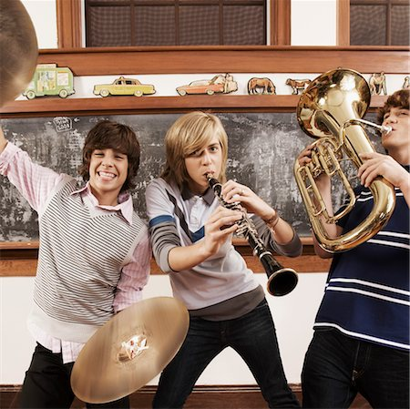Three teenage boys playing musical instruments in a classroom Stock Photo - Rights-Managed, Code: 837-03074534