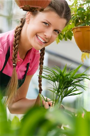 Woman working in a greenhouse Stock Photo - Rights-Managed, Code: 837-03074574