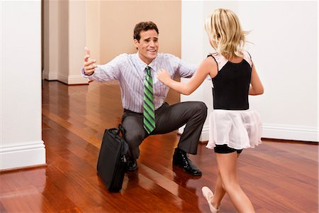 Businessman receiving a warm welcome from his daughter Stock Photo - Rights-Managed, Code: 837-03074577