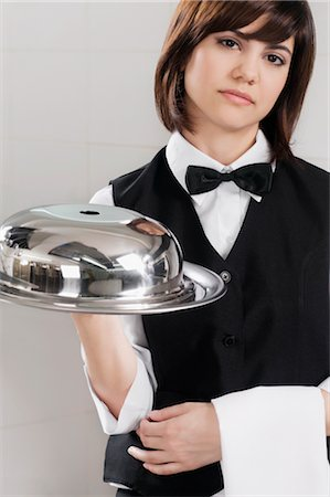 Portrait of waitress holding a domed tray Stock Photo - Rights-Managed, Code: 837-03074660