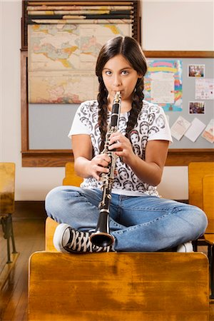 Schoolgirl playing a clarinet in a classroom Stock Photo - Rights-Managed, Code: 837-03074735
