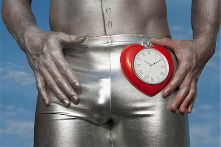 Mid section view of a gay man holding a heart shape clock,Washington DC,USA Stock Photo - Rights-Managed, Code: 837-03074921