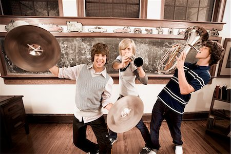 Three teenage boys playing musical instruments in a classroom Stock Photo - Rights-Managed, Code: 837-03074998
