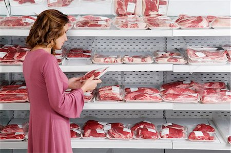 Woman buying meat in a supermarket Stock Photo - Rights-Managed, Code: 837-03075001