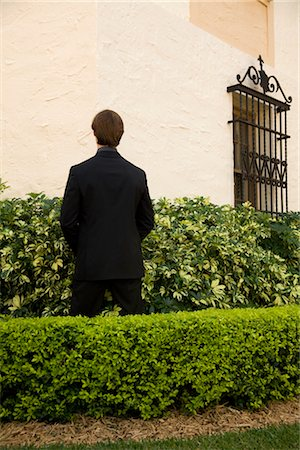 Businessman urinating in a formal garden,Biltmore Hotel,Coral Gables,Florida,USA Stock Photo - Rights-Managed, Code: 837-03075070