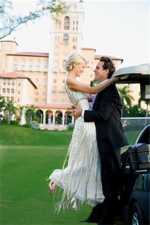 Couple romancing in a golf course and smiling,Biltmore Golf Course,Biltmore Hotel,Coral Gables,Florida,USA Stock Photo - Rights-Managed, Code: 837-03070055
