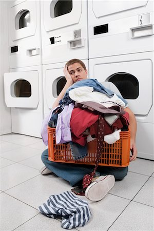 Man with a basket in a laundromat Stock Photo - Rights-Managed, Code: 837-03070402
