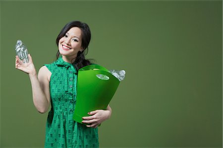 Portrait of a woman holding a recycling bin Stock Photo - Rights-Managed, Code: 837-03070540