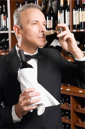 Waiter smelling cork of a wine bottle Stock Photo - Rights-Managed, Code: 837-03070752