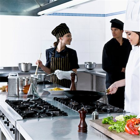 Chefs cooking food in the kitchen Stock Photo - Rights-Managed, Code: 837-03071046