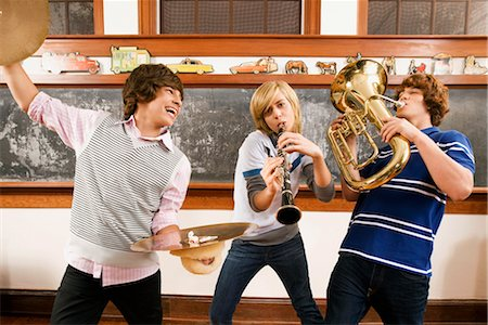 Three students playing musical instruments in a classroom Stock Photo - Rights-Managed, Code: 837-03071251