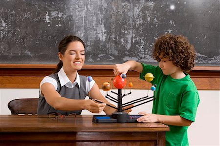 pre-teen boy models - Schoolboy and his teacher with model of solar system in a classroom Stock Photo - Rights-Managed, Code: 837-03071479