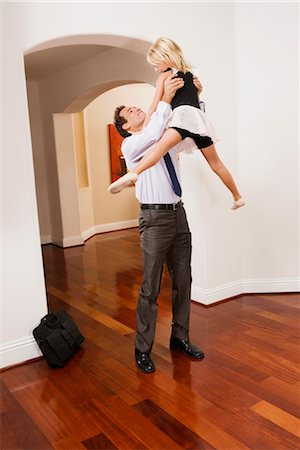 Businessman picking up his daughter Stock Photo - Rights-Managed, Code: 837-03071563