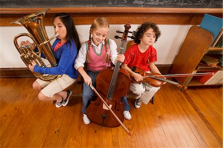 Three students playing musical instruments in a classroom Stock Photo - Rights-Managed, Code: 837-03071853